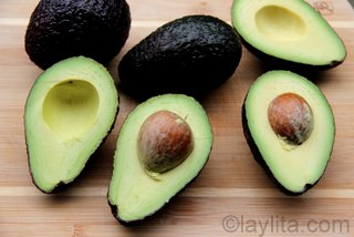 Cut the avocados in half, remove the seed and peel the skin
