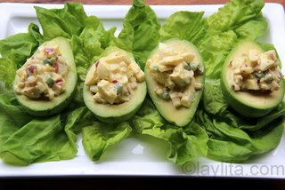Fill avocado centers with egg salad