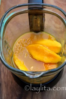 Combine mango, passion fruit concentrate or jice, lime juice and sugar in the blender