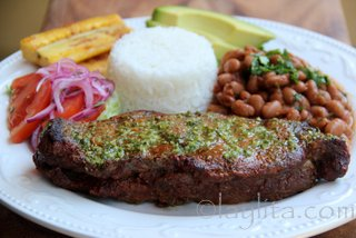 Grilled steaks with rice and beans