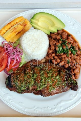 Latin-style grilled steak with rice, beans and plantains