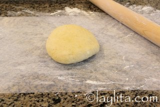 Roll out the dough on a lightly floured sheet of wax paper