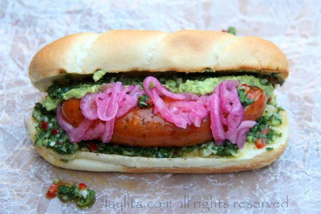 Choripan can also be served with pickled red onions and some guacamole for the ultimate Latin hot dog experience