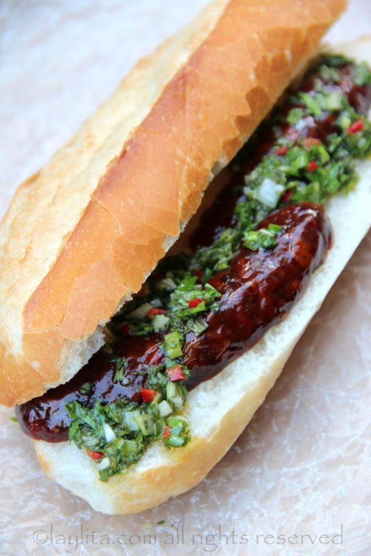 Choripan sandwich with chimichurri sauce