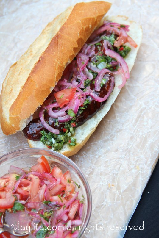 Choripan with chimichurri and onion tomato salsa