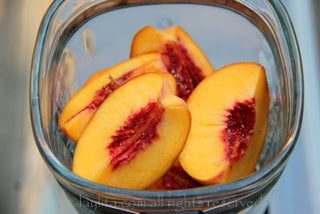 Blend the quarted peaches with a little bit of water