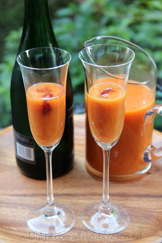 Pour the peach puree and a dash of raspberry liqueur into each glass