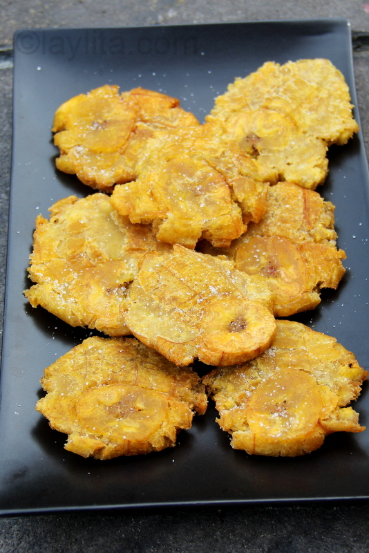 Patacones, tostones or thick green plantain chips