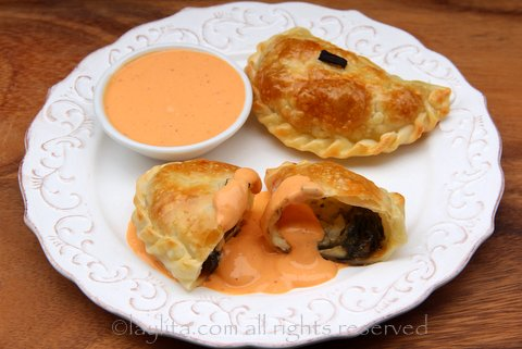 Poblano cheese empanadas with chipotle sauce