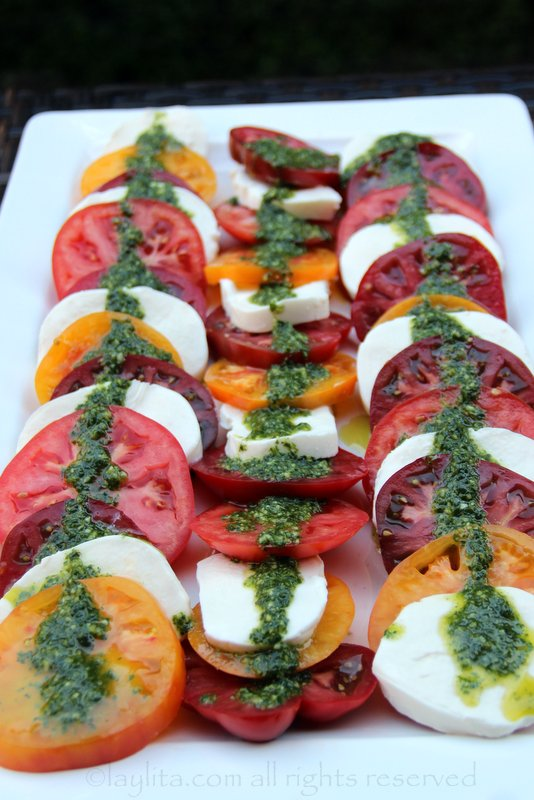 Arrange the tomato and mozzarella slices in slightly diagonal layers