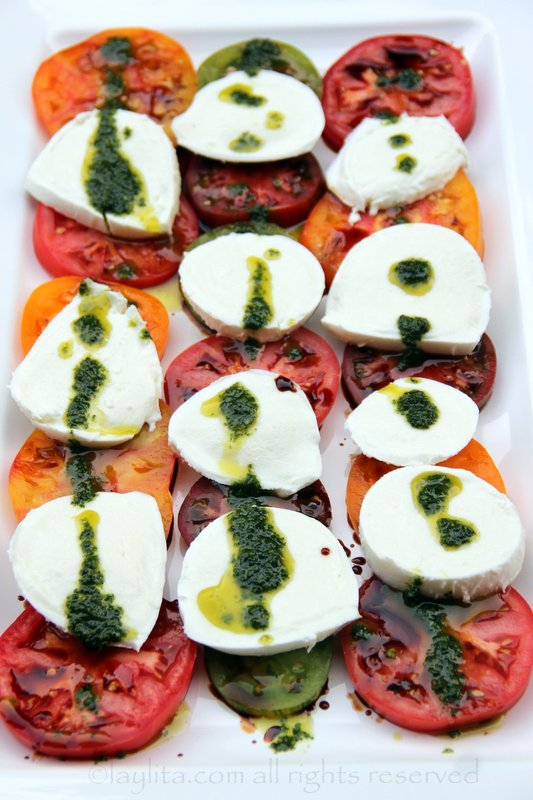Or place the mozzarella slices on top of the tomato slices