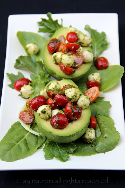 Avocados stuffed with caprese salad