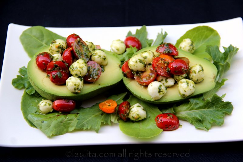 Use a spoon to fill the avocado halves with the caprese filling