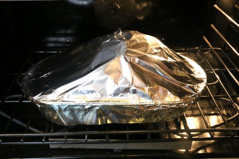 Cover the ham with foil and baked in pre-heated oven at 325F for 1 hour