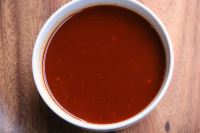 Remove the cinnamon stick and clove from orange chipotle sauce, save until ready to use