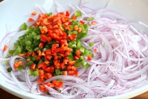 Sliced onions and hot peppers for avocado salsa