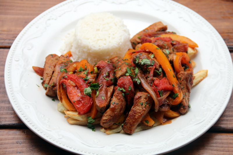 Serve the pork stir fry with french fries and rice
