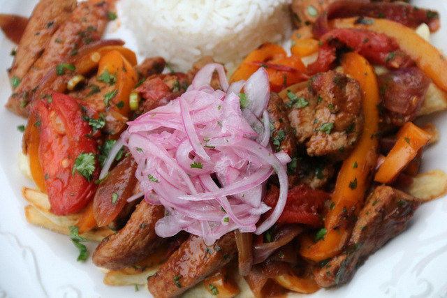 Lomo saltado with lime pickled red onion curtido salsa