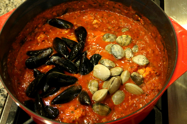 Add the mussels and clams