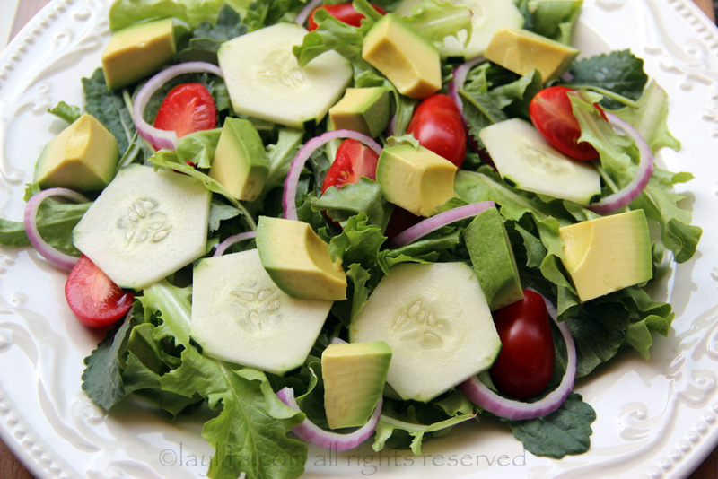 Salad greens, avocado, tomato, cucumber and onions