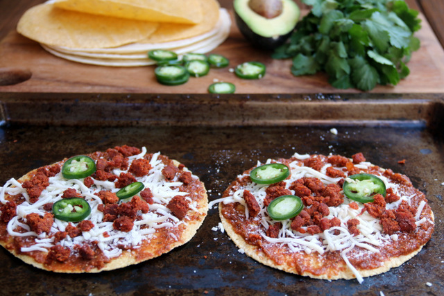For a choriqueso tortilla pizza add cooked chorizo and jalapeno slices