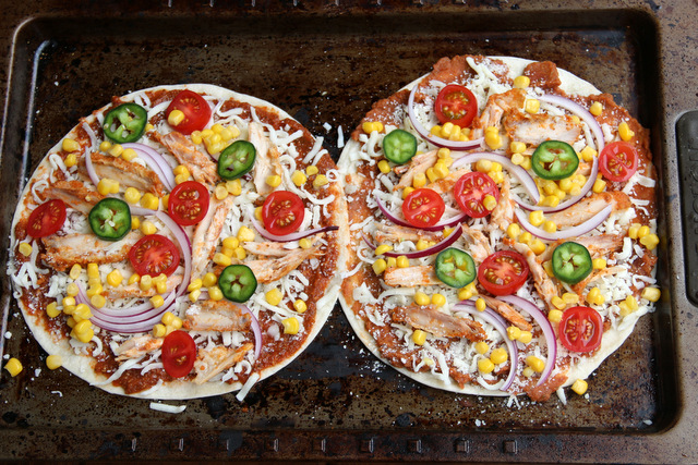 Tortilla pizza topped with chicken, corn, tomato, onion and jalapeño