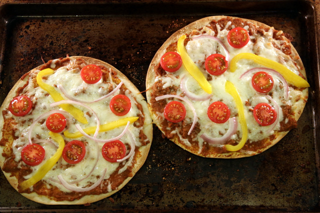 Bake the tortilla pizzas in a pre-heated oven at 450F for 6-8 minutes
