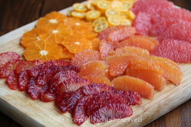Cut the oranges and grapefruit into segments