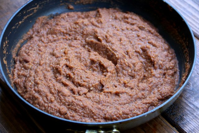 For the refried bean sauce, mix refried beans with some of the tomato sauce
