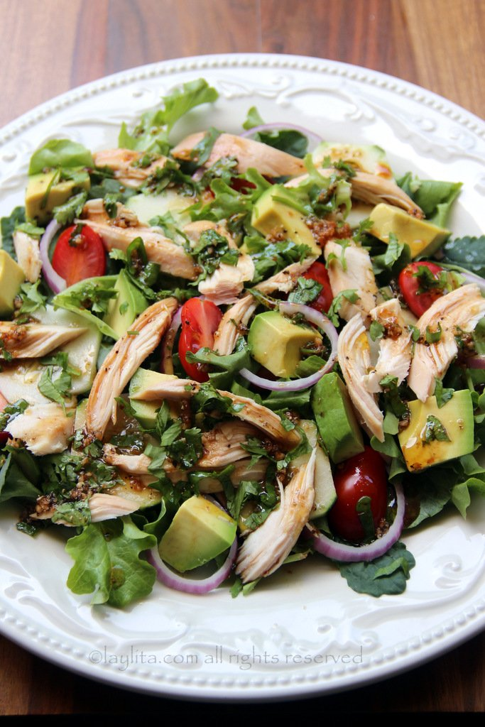 Mixed Greens Cucumbers Onions Tomatoes And Avocado Chicken Vegetable Salad With Balsamic Cilantro Dressing