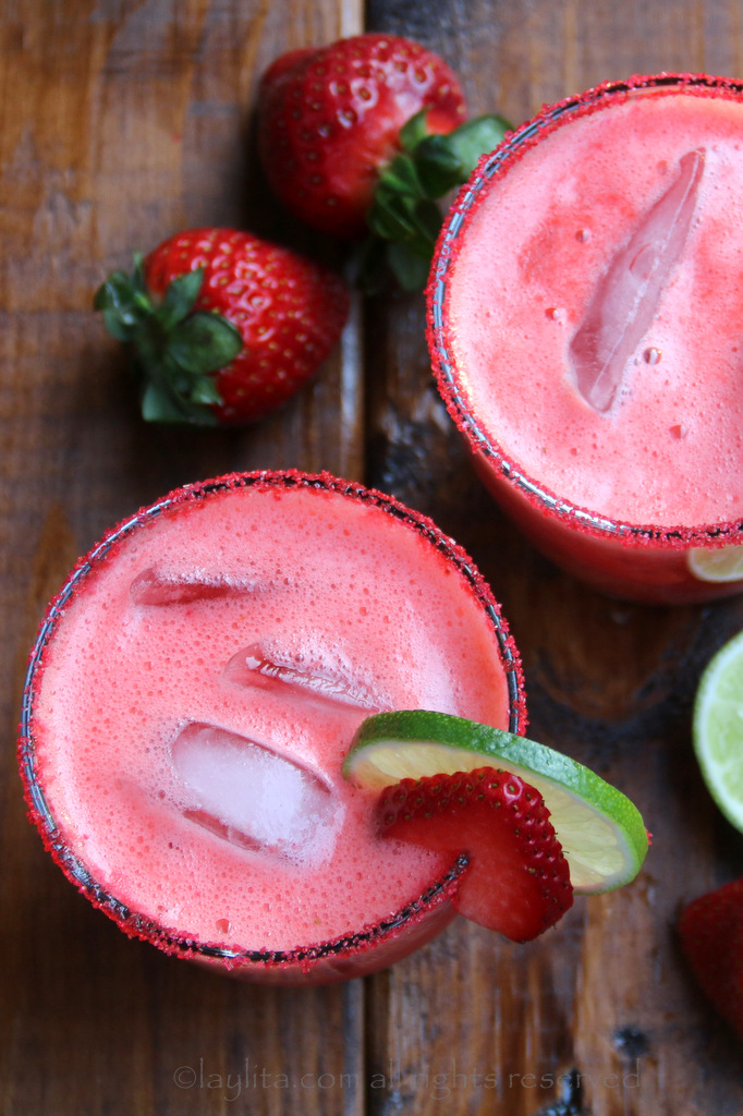 Homemade strawberry margaritas made with fresh strawberries, lime juice, sugar or honey, orange liqueur, and tequila.