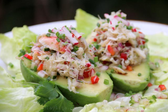 Fill the avocados with the crab salad