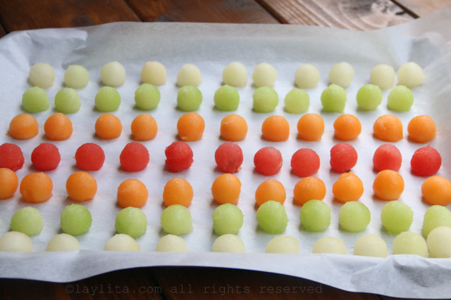 Arrange the melon balls on a baking sheet lined with parchement or wax paper