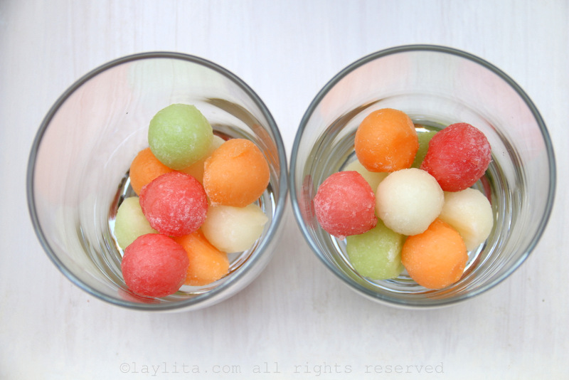 Serve over ice cubes or freeze additional melon balls to use as ice cubes