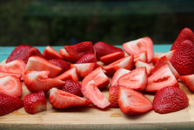 Cut the strawberries into quarters or halves (whatever is easiest to blend)