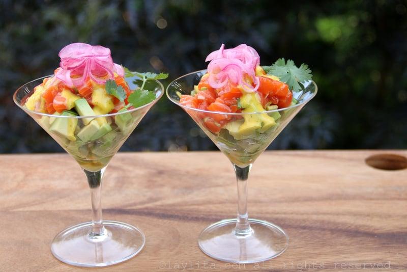 Avocado and salmon tartare in cocktail glasses