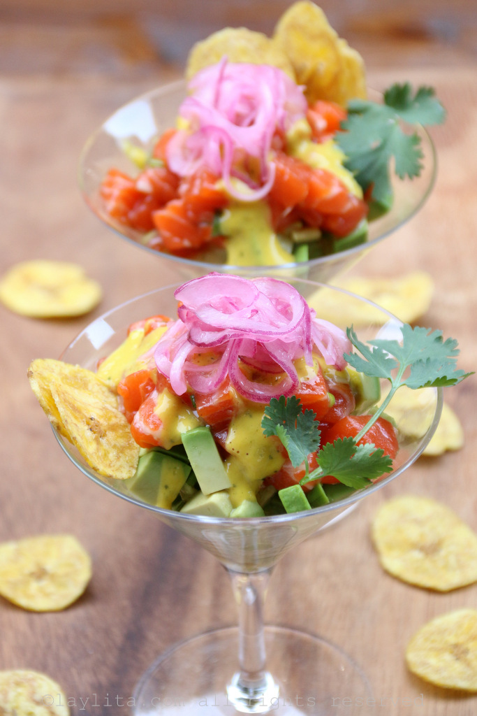Avocado and salmon tartare with mango habanero sauce, pickled red onions and plantain chips