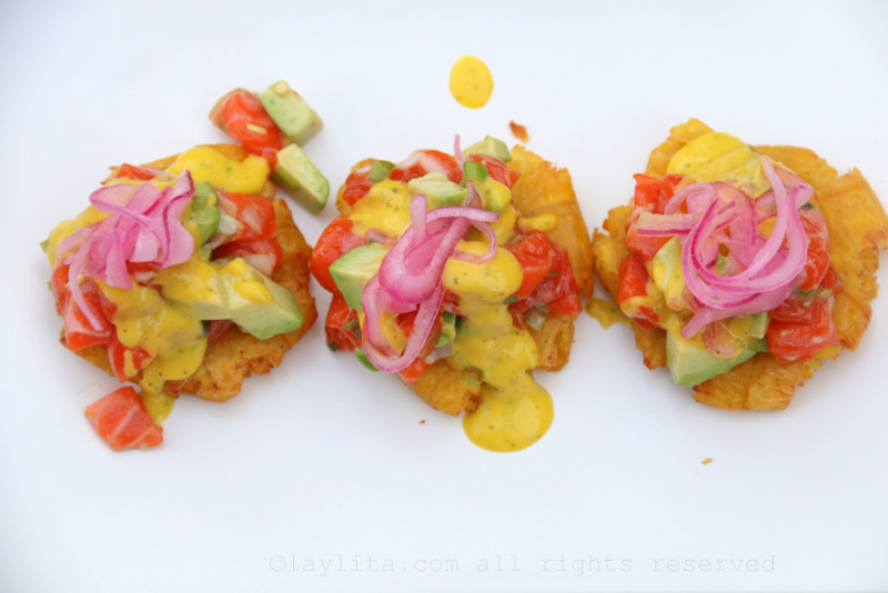 Tostones or patacones plantain chips with avocado salmon tartare