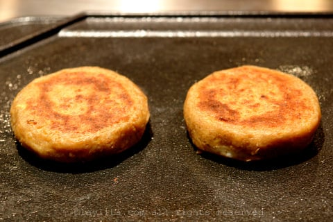 Cook the plantain patties on a hot griddle o frying pan until crispy on each side.