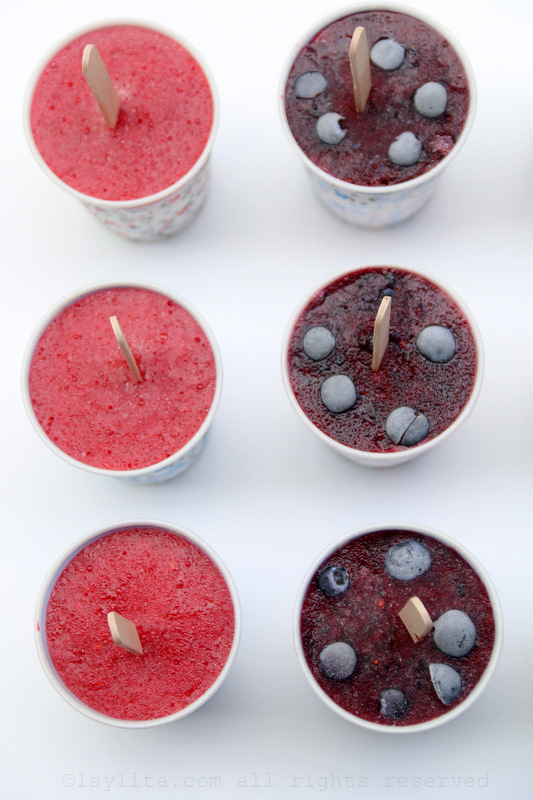 Berry layered red white and blue popsicles