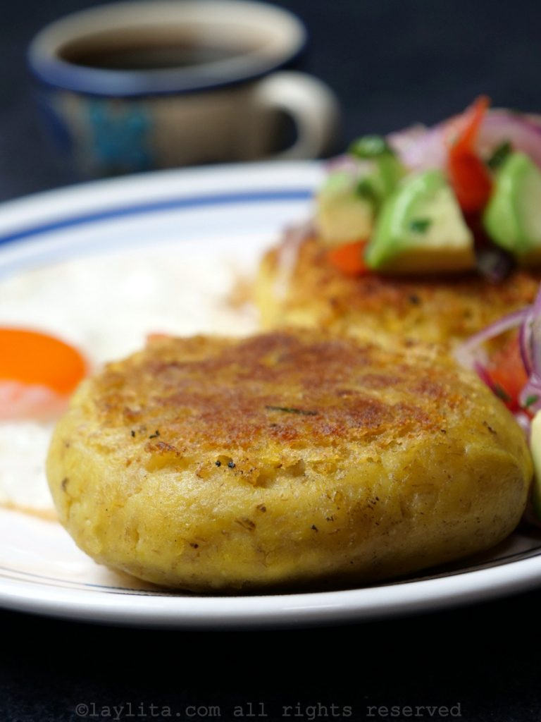 Green plantain cakes or patties filled with cheese