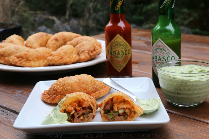 Fried langostino or crawfish empanadas with a spicy avocado dipping sauce