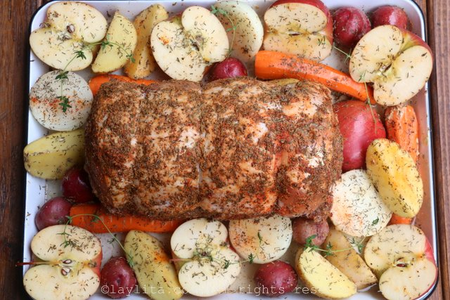 Rub the seasoning mix on the pork and place it in a roasting pan with the apples and vegetables