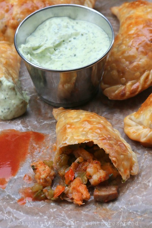 Langostino and Andouille sausage empanadas with avocado dipping sauce