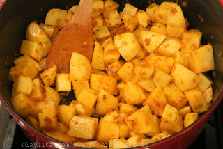 Make a refrito, then deglaze with white wine, and add the potatoes