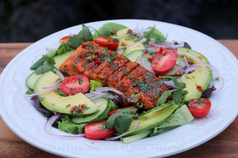 Salad with grilled fish, avocados and lime cilantro dressing