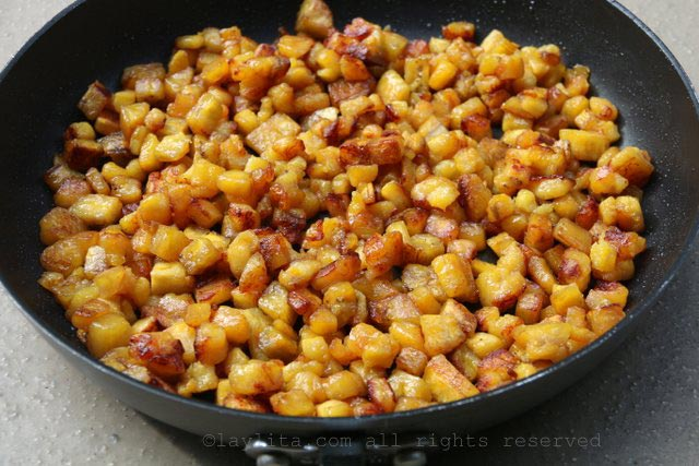 Cook the diced ripe plantain cubes until they are golden and caramelized