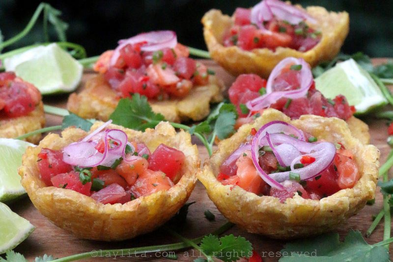 Drizzle the ceviche with lime juice and top with red pickled onions