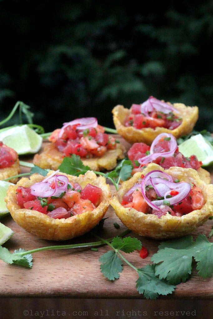 Poke style tuna and salmon ceviche in plantain cups with pickled red onions