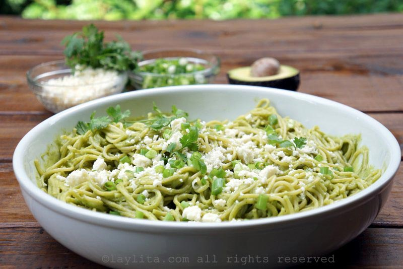 Serve the avocado spaghetti with crumbled queso fresco and chopped green onions